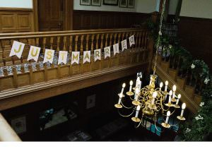 view over the balcony at Persie House wedding party sign and chandelier