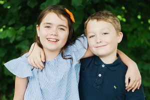 Brother and sister, colour picture with arms around each other