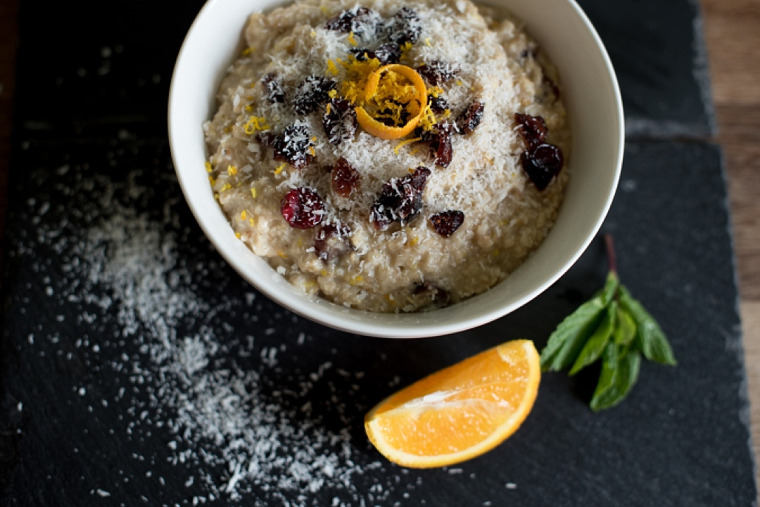 healthy eating porridge with orange on a slate